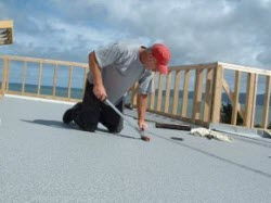 rolling the bonded surface to remove air bubbles and ensure full contact