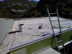 entire roof is sanded, to level off epoxy and roughen surface for new coating