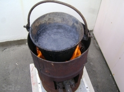 the asphalt blocks were melted in this LPG fired repair pot