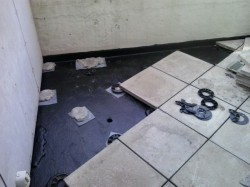 pavers reinstalled on plaster pads and spacer rings
