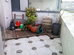 pavers and pots stacked on other half