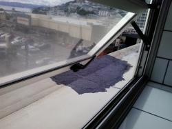 patch on metal ledge flashing, taken from window