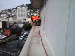 another job, ledge on side of building, harness work