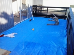 deck tarped up for the night, low temperatures=heavy dew forecast