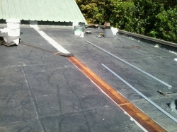 another seam is cut out and the EPDM removed