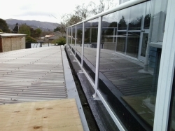 outside fence, gutter, carport roof, post feet coated with 1st coat Traffigard FD