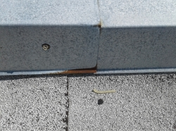 there is some surface rust on the galvanized metal parapet flashings