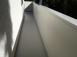 coating the narrow walkway with second and final application of Unisheild
