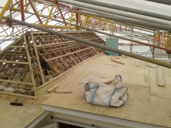 view over level 2 main flat roof inside shrinkwrapped structure