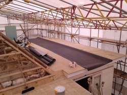 9.0 metre long by 3.0 metre wide main sheet of level 2 roof in place