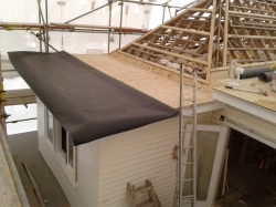 back roof level 2, one piece folded back in half ready for adhesive