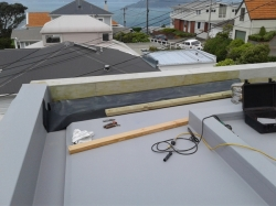 parapet piece on east end of roof, 2 pieces to match slope of roof