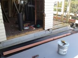 internal corner of rear roof, large upstand under door cill
