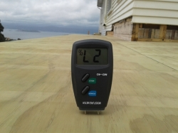 moisture content of plywood at 27% is too high to lay TPO membrane