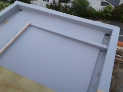 view down on completed TPO roof from level above