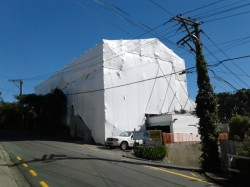 scaffolding shrink wrapped over 98% of house