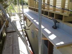 back ledge with TPO folded over and fastening bar installed