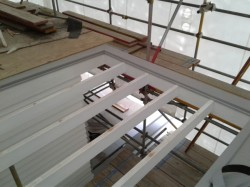 exposed rafters at front, turndown and fastening bars installed