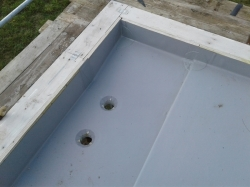 outlet and overflow at north end of roof