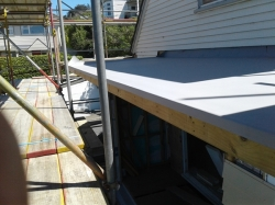 view along front eastern side of upper level roof with turndowns folded and glued to aluminium drip edge