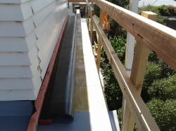 narrow ledge, long piece, timber weight to prevent springing back down when folded