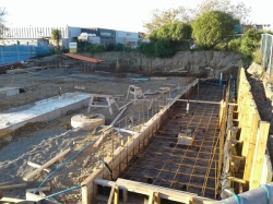the building site, footing and part of floor, note polythene under steel mesh and excess to right hand side