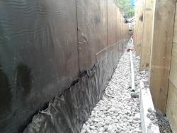 cover strip over polythene is also reinforcing strip at footing/block junction