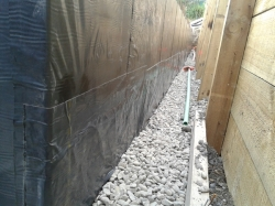 view along bottom of wall at footing level