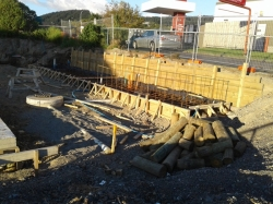 view of site, timber retaining wall to hold neighbours driveway during work