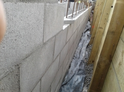 footing concrete has been poured and 3 block high retaining wall, access to apply membrane is very tight 300mm