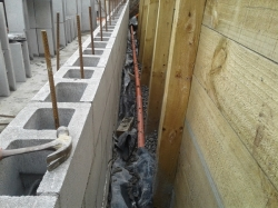 view along base of wall/footing, note excess polythene from under the footing
