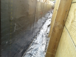 polythene from under the floor and wall membrane coated with bitumen adhesive
