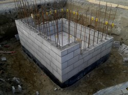 concrete blockwork for lift shaft, boxing removed from floor/footing sides