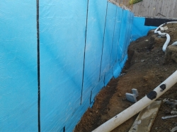 view back along wall to the north, footing and DPC now covered with additional pieces of membrane