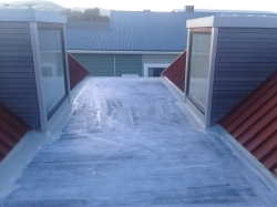 more hydroepoxy priming, on the L shaped roof, view downslope to the north from the high point