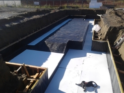 a day later the water is rmoved and corflute protection board laid ready for steel reinforcing cages