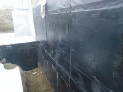 east cast concrete wall, first layer applied