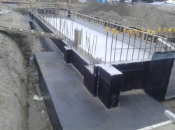 south cast wall and west footing slab coated with 2nd primer, bitumen based