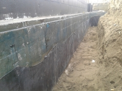 membrane being repaired on the footing side