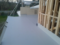 upstand at north end glued to parapet wall