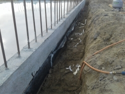 bitumen primer to side of footing where membrane loose