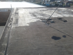 original builtup asphalt roof over coated with emulsion