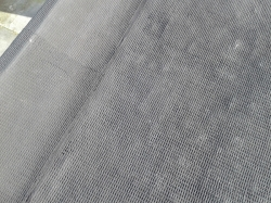 closeup view of texture of mesh and emulsion overlay
