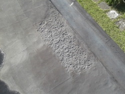 a small section showing original gravel surface under mesh overlay