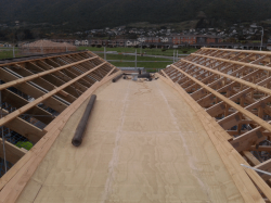 large plywood valley between two pitched roofs, looking east
